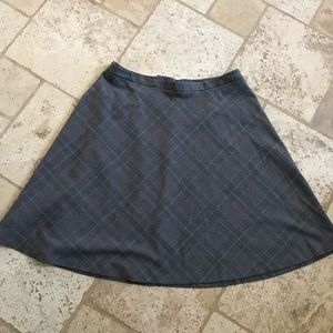 A line suiting plaid skirt